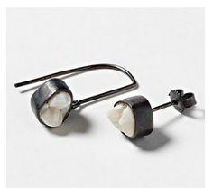 human tooth earrings.  van der glas