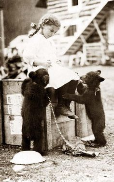 thehistoryprofessor:    A little girl with some bear cubs, c.1900  via old-pictures.com