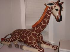 paper mache giraffe - this thing is awesome (I always wanted a safari room when I was little...)