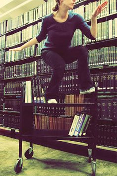 Book Cart surfing....i want to have a fun library photo shoot. I should have done this while I volunteered at the library!
