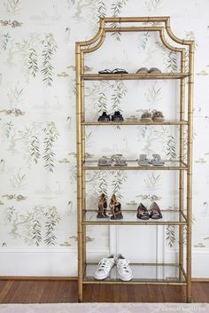 Vintage gold bamboo etagere, shoe shelf, swan lake wallpaper  room by Design Manifest