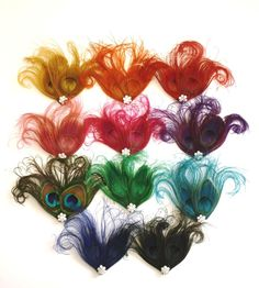 Gold Peacock Feather Hairclip, Wedding Hair Accessory, Bridesmaid fascinator. $22.00, via Etsy.