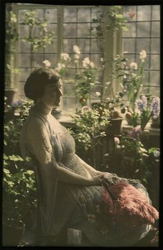 Autochrome: Woman in greenhouse, ca 1910, by Mrs. Benjamin F. Russell.