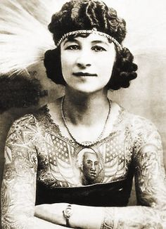 Artoria Gibbons    Artoria was a tattoo attraction that worked for 35 years in circus and carnival sideshows. Artoria was the stage name for Mrs. C. W. (Red) Gibbons.