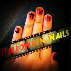 Halloween nails!! Used orange opi nail polish and black nail art brush!