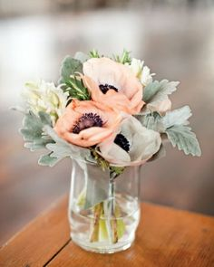 Peach and white anemones with dusty miller