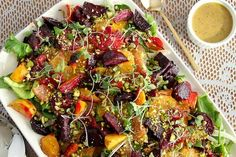 Roasted Beet and Citrus Salad with Mustard Vinaigrette via Snixy Kitchen | This multi-layered salad is as beautiful as it is flavorful. Roasted beets, sliced citrus, fennel, pistachios, and a honey-mustard dressing provide a good balance of sweet, sour, and savory.