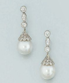 A pair of cultured pearl and diamond earpendants Each with single cultured pearl drop, approximate diameters 10.4 and 10.5 mm., to brilliant-cut diamond caps and brilliant and marquise-cut diamond three stone suspension, post fittings