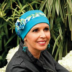 """Rosette Turban.  Sweet, easy, all day comfort from Hats, Scarves and More. Our new Rosette Turban comes with a soft matching rosette and band sewn right in for an updated look. Fits head sizes 21.5""""-23.5"""". Hand crafted with care in the USA. A wonderful turban for cancer patients. Makes a great gift for women with medical hair loss."""