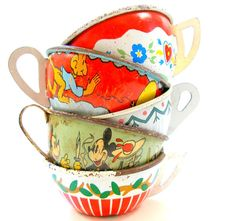 Ohio Art and J. Chein tin toy teacups. From Allie's shop on etsy.