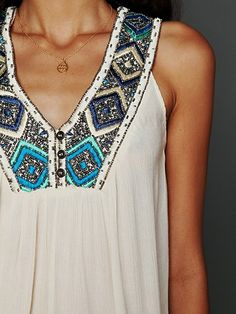 Sleeveless embroidered top.