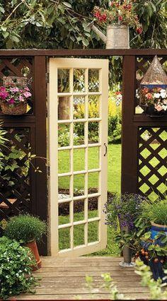 Repurposing old door, without windows, as garden gate.