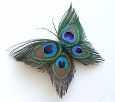 Butterfly Peacock Hair Clip Accessory Peacock Feather Fascinator Hair Piece  Butterfly Peacock Feather Hair Accessories Butterfly Hair Clip. $29.00, via Etsy.