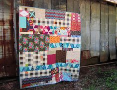 Quilt made with leftover blocks: stitched in color