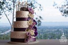 Purple wedding cake, wedding at the Odyssey, Granada Hills by Los Angeles wedding photographer Faith-Michele Photography.  http://faith-michele.com/maryhelen-scott-at-the-odyssey-los-angeles-wedding-photographer/