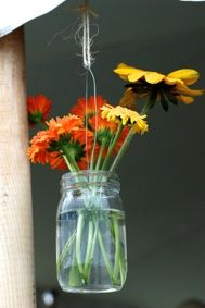 Flowers in a mason jar for decor.   Post by One tomato, two tomato.