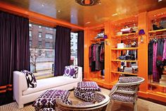 How to Get the Tory Burch Look at Home// Tory Burch store design with orange high-gloss millwork, ikat upholstery, and leopard-inspired chairs