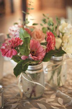 Mason jar vases, simple raffia...hmmm, could use spaghetti jars instead of mason jars