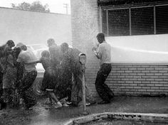 """Unseen Civil Rights Photos May 1963, Children's Marchers pushed back by fire hoses.  During the Birmingham campaign of 1963, City Commissioner Eugene """"Bull"""" Connor jailed hundreds of protesters and authorized the use of fire hoses and police dogs on others. This image was one of many published in the mass media that raised a public outcry to end civil rights abuses in the South.  Photo credit: The Birmingham News"""