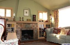 1906 Queensberry RD, Pasadena, CA - Estately $635K. Wow, look at that fireplace; I want a close up. I'll bet that's all Batchelder tile. With the application of some paint remover, this room would be grand!