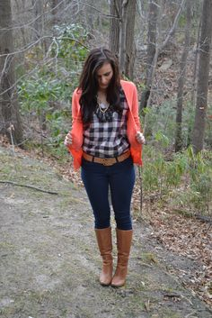 Plaid shirt, dark skinnies, cognac belt and boots, bright coral sweater