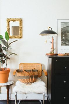 Love the simple styling with the white walls (via the elegant cast)