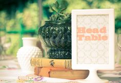 Vintage book and glass centerpiece