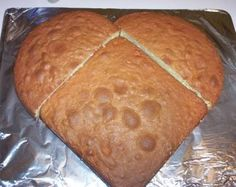 "Easy way to make a heart shaped cake: one 8"" round, one 8"" square, cut round in half to make the top of the heart. Easy! Maybe make with cherry cake mix? Def will make."