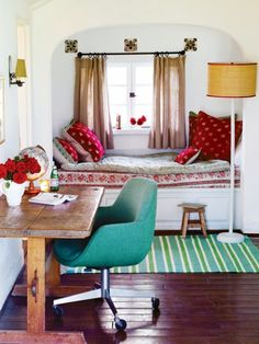 Oh what a nook! from Canadian House & Home - the colors are excellent and I love that rustic wood table.