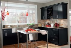 An elegant black finish kitchen cabinet set. Customize with wine storage options and matching mud room possibilities.