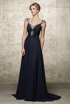 Mother of the Bride dresses by Alyce Paris Jean de Lys 29421. Poly Chiffon one piece long dress with off-the-shoulder neckline. Gathering at the center with sequin beading running down center of bodice and the sleeves. Two piece. Shown in Navy.