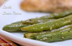 Garlic Green Beans 2 tbsp Olive Oil 2 c green beans 1 t minced garlic ½ t kosher salt ½ t pepper 1 t melted butter  Preheat oven to 350 degrees. Boil green beans, 2 minutes. Place beans in a shallow baking dish and combine with other ingred. Bake at 350 for 15 minutes.