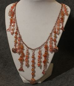 Copper chain and findings, red aventurine chips and rounds, millefiori beads, copper beads. For sale.