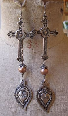 I ♥ these earrings...heart's and cross's ♥