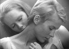 Susan Sontag has described the plot of Bergman's Persona (1965) as 'two women bound together in a passionate agonized relationship' which 'is rendered mythically as vampirism:  at one point, Alma sucks Elizabeth's blood.'