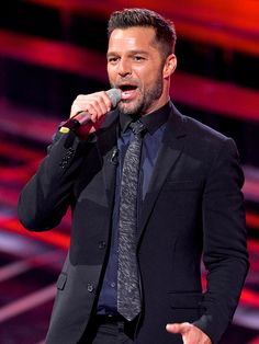 Ricky Martin smiles and sings while making his debut appearance as a judge on the Mexican version of The Voice on Monday.