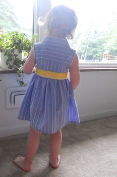 The Upcycled Shirt Dress DIY Pattern  Use dad's old shirt to make a dress for daughter. So cute!