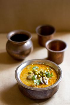 south indian mushroom & peas curry - rich, aromatic and delicious curry made with coconut - cashew base.