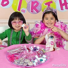 A fashion station is a must for any stylin' sista! These fashionistas adore this dress up session with Barbie boas and tiaras!