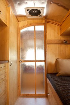 Bathroom Door lets in lots of Light- great idea for bathroom door in trailer!