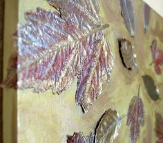 DIY Fall Leaves on Canvas - Amazing! They look like painted metal, but they are real leaves! LOVE this idea