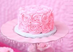 Rosette smash cake - need two batches of icing.  One for smooth coat and then one again for rosettes.  Use 1M cake decorating tip.