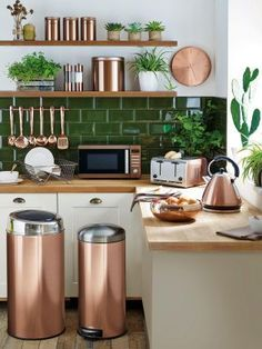 These copper kitchen accessories add a diversity in material against this kitchen shelving and back splash tile. #copperkitchen #kitchenaccessories #copperkitchenaccessories #copperpans #copperkitchenware