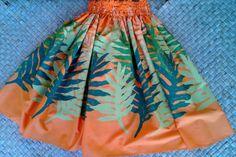 A bright orange pa'u skirt with laua'e leaves of by SewMeHawaii