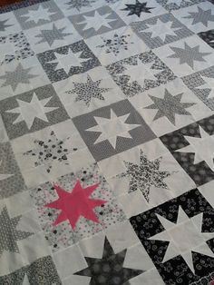 Wonky star quilt top.  All black and white with one block of pink star and pink ribbon fabric in honor of Mim & Mama.  Miss them every day!