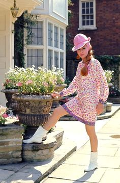 """A style of boot that was very popular among girls in Southern California when I was a teen in the 1960s...They were a low flat heeled, white leather or vinyl boot...sometimes tight-fitted but usually with a loose-fitting top line like in this photo ...they were all known by the catch phrase of """"Courrèges"""". We didn't know they had anything to do with the French designer Courrèges."""