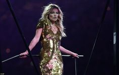 Supermodel: As the stadium is turned into a giant catwalk, London-born model Kate Moss appears wearing a gold Alexander McQueen dress