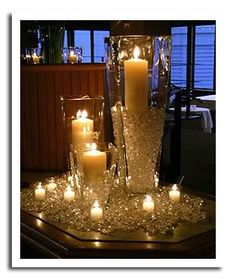 Gorgeous centerpieces for any evening event, white candles and lots of sparkle!