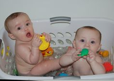 Use laundry basket as seat in bath tub. Helps keep them from hitting head on hard tub, and keeps toys from floating out of reach.