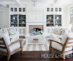 Living room love: painted open shelves, natural brick fireplace, white & neutral scheme